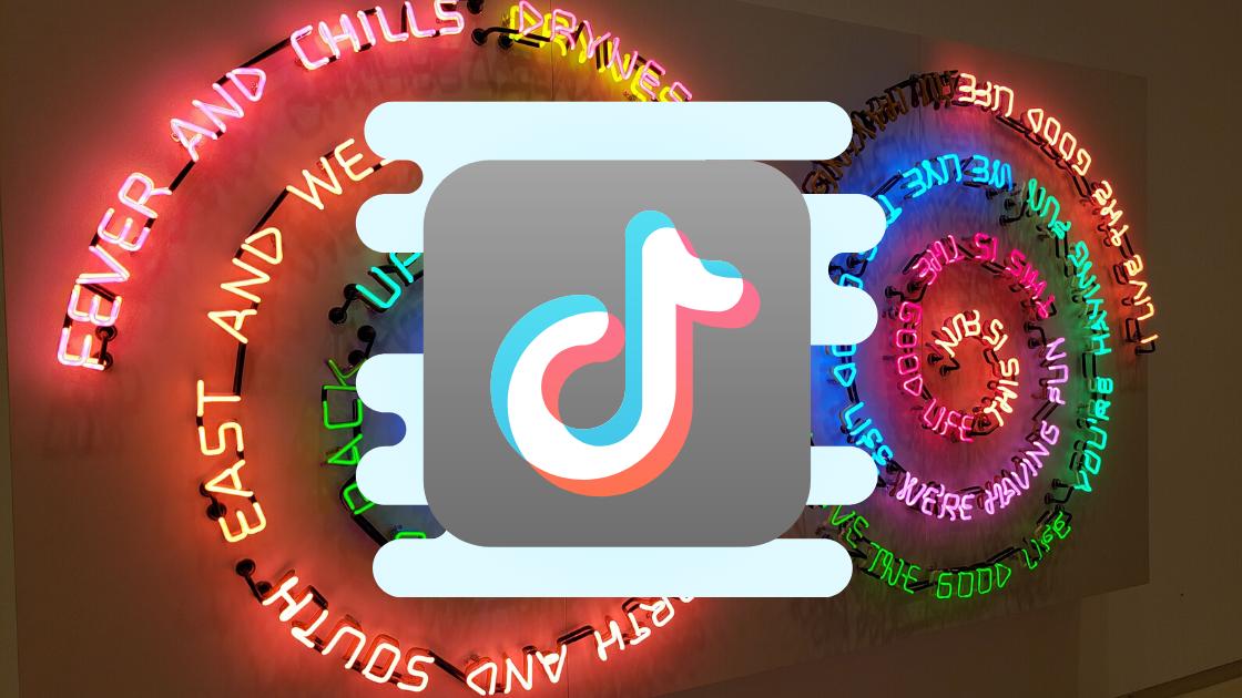 TikTok logo over neon