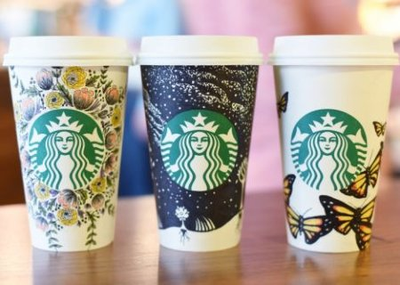 Three Starbucks' cups with hand-drawn illustrations for white cup UGC campaign