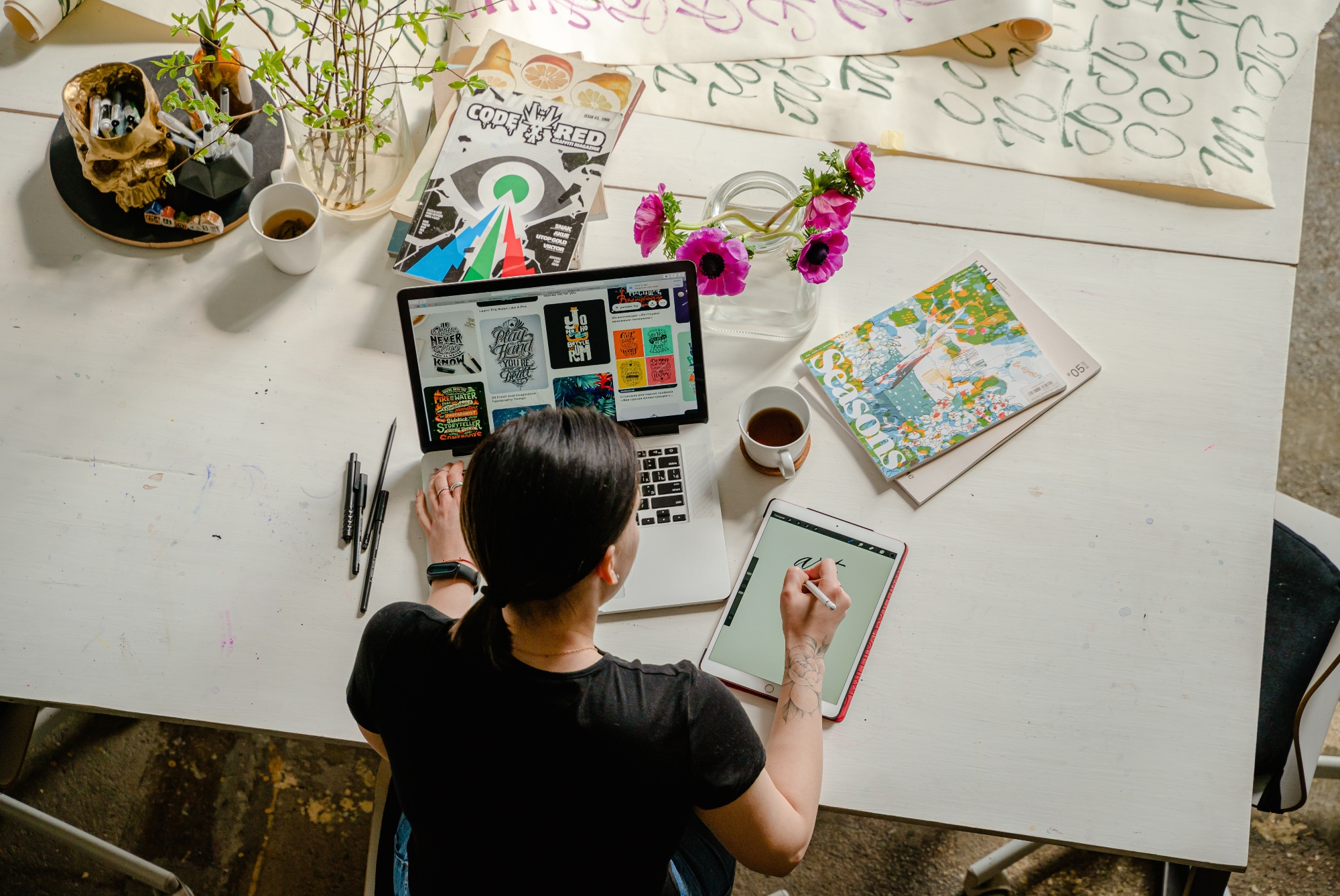 Woman drawing on computer making content
